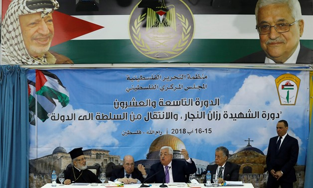 Palestinian President Mahmoud Abbas gestures as he speaks during the meeting of the Palestinian Central Council, in Ramallah, in the occupied West Bank August 15, 2018. REUTERS/Mohamad Torokman
