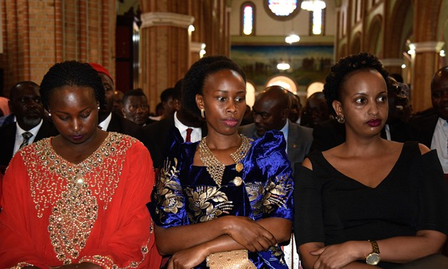 Barbie Kyagulanyi (C), wife of prominent opposition politician Robert Kyagulanyi known as Bobi Wine, attends the prayer for her husband at Rubaga Cathedral Church in Kampala on August 22, 2018.-AFP/  ISAAC KASAMANI