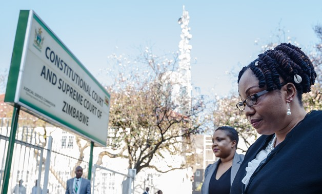 Zimbabwe Electoral Commission (ZEC) chairperson Priscilla Chigumba arrives at Harare courthouse, on August 22, 2018, ahead of the sitting of the Zimbabwe Constitutional Court to hear a petition by the main opposition seeking to overturn the results of the
