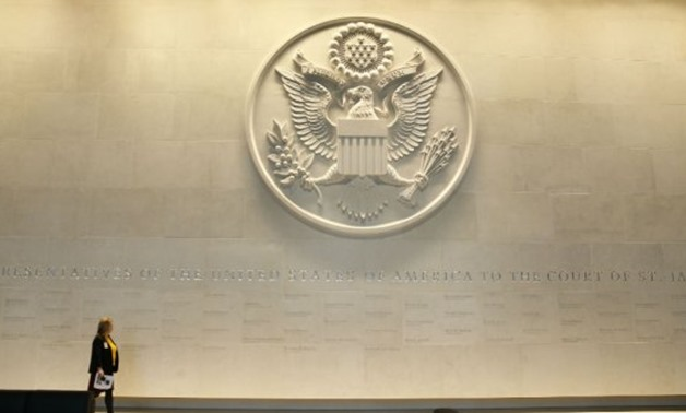 © Alastair Grant / POOL / AFP | A large Department of State embossed seal.