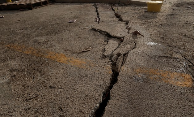 File: A crack is seen on the ground after an earthquake - Reuters