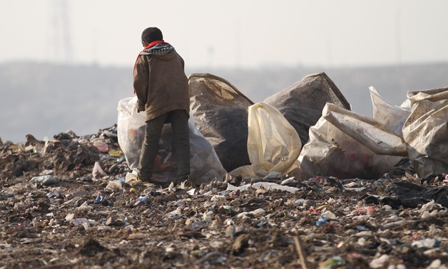 File- A street child collects garbage in Katamyia district- Cairo/Egypt Today/Maher Iskander