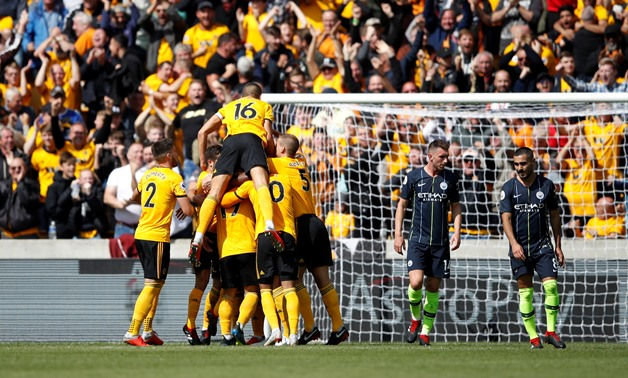 Soccer Football - Premier League - Wolverhampton Wanderers v Manchester City - Molineux Stadium, Wolverhampton, Britain - August 25, 2018 Wolverhampton Wanderers' Willy Boly celebrates scoring their first goal with teammates Action Images via Reuters/Carl