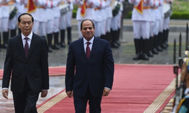 File Photo: Egypt's President Abdel-Fattah El-Sisi (R) and Vietnamese counterpart Tran Dai Quang (L) during a welcoming ceremony at the presidential palace in Hanoi in September 2017 (Photo: AFP)
