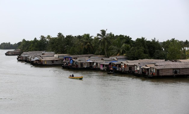 A motorboat moves past a row of empty houseboats in a tributary of the Pamba river following floods in Alappuzha district in the southern state of Kerala, India, August 24, 2018. REUTERS/Sivaram V