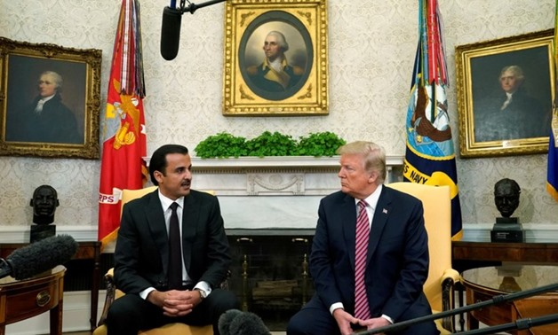 U.S. President Donald Trump meets Qatar's Emir Sheikh Tamim bin Hamad al-Thani in the Oval Office at the White House in Washington. U.S., April 10, 2018. REUTERS/Kevin Lamarque Via REUTERS