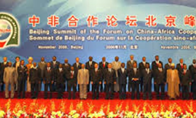 Chinese President Hu Jintao (C Front), Ethiopian Prime Minister Meles Zenawi (L Front) and Egyptian President Hosni Mubarak (R Front) jointly read out the declaration of the Beijing Summit of the Forum on China-Africa Cooperation (FOCAC) at the Great Hall