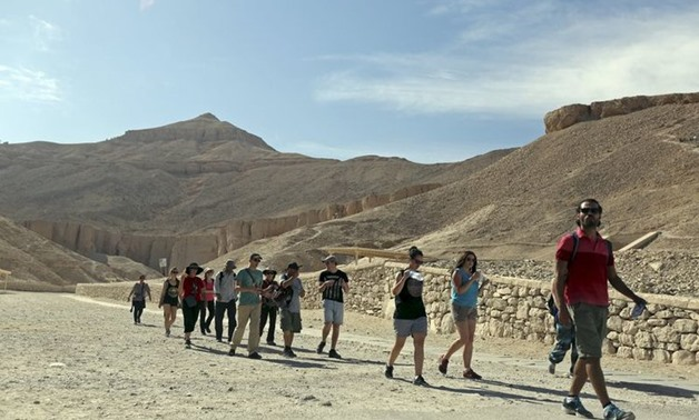 Tourists are seen at the Temple of Hatshepsut, a day after a hot air balloon crash left 19 foreigners dead, in Luxor, February 27,2013- Reuters/ MOHAMED ABD EL GHANY