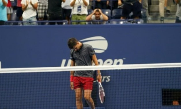 © AFP | Tough defeat: Dominic Thiem walks off after losing to Rafael Nadal