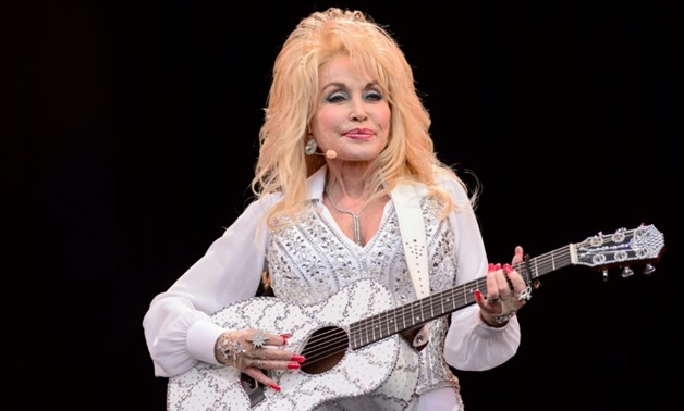 In this file photo taken in 2014, Dolly Parton performs on the Pyramid Stage in Somerset, England-AFP/File / LEON NEAL