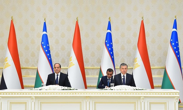 Egyptian President Abdel Fatah al-Sisi (L) and Uzbek President Shavkat Miromonovich (R) attend ceremony of signing a number of agreements- press photo