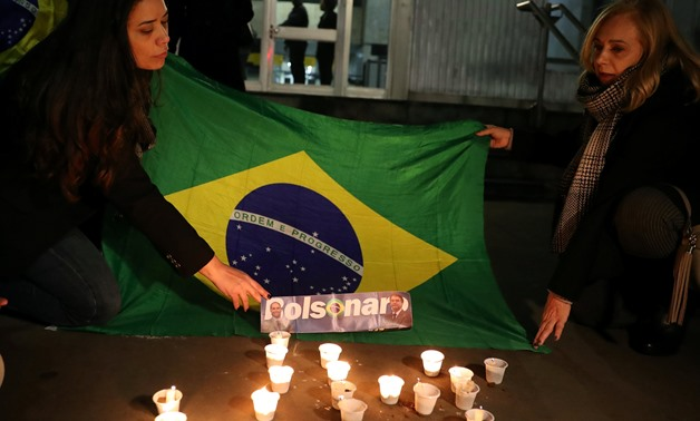 People light candles for presidential candidate Jair Bolsonaro after he was stabbed by a man in Juiz de Fora at Paulista avenue in Sao Paulo, Brazil September 6, 2018. REUTERS/Paulo Whitaker