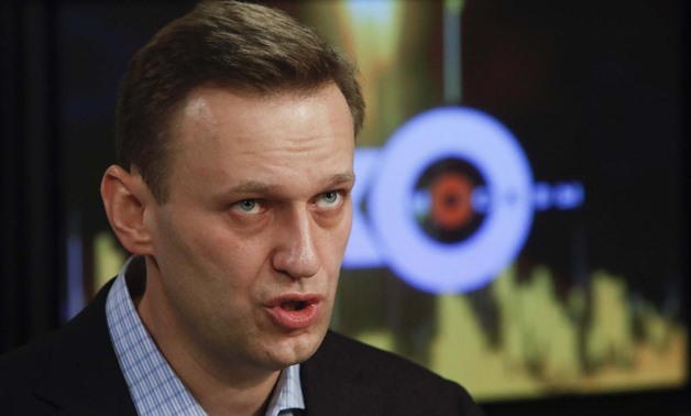 Russian opposition leader Alexei Navalny speaks in the studio of the radio station Echo of Moscow in Moscow, Russia December 27, 2017. REUTERS/Sergei Karpukhin