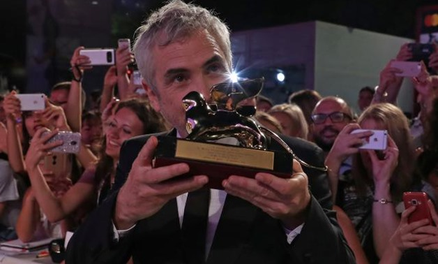 The 75th Venice International Film Festival - Awards Ceremony - Venice, Italy, September 8, 2018 - Director Alfonso Cuaron poses with the Golden Lion for Best Film. REUTERS/Tony Gentile.