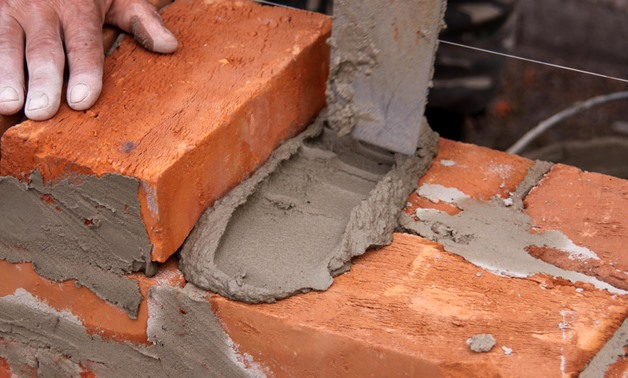 Causing the bricks to cement- CC viatorange.biz
