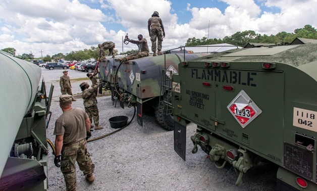 South Carolina National Guard soldiers transfer bulk diesel fuel into fuel tanker trucks for distribution in advance of Hurricane Florence, in North Charleston, South Carolina, U.S. September 10, 2018. U.S. Army National Guard/Sgt. Brian Calhoun/Handout v