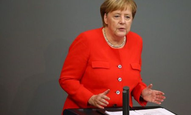Germany's Merkel condemns far-right xenophobia, Nazi slogans