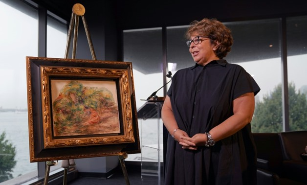 "A Pierre Auguste Renoir painting ""Femmes Dans Un Jardin,"" stolen by the Nazis, has been returned to the heir of its rightful owner, Sylvie Sulitzer, seen here at a ceremony at the Museum of Jewish Heritage in New York-AFP / TIMOTHY A. CLARY"
