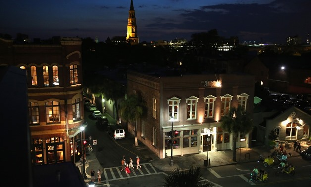 Tourists walk through the historic district on July 15, 2015 in Charleston, South Carolina. The second largest city in South Carolina, Charleston is known for its well-preserved architecture and was named 'America's Most Friendly City' in 2014 by Conde Na