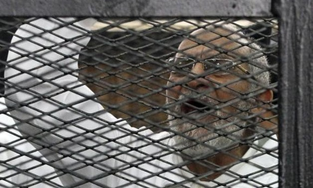 Muslim Brotherhood leader Mohammed Badie shouts slogans from the defendant's cage during his trial with other leaders of the Brotherhood in a courtroom in Cairo December 11, 2013. Credit: Reuters/Stringer