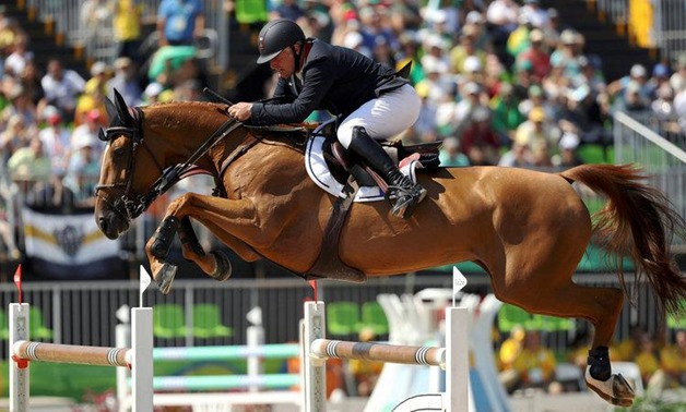 2016 Rio Olympics - Equestrian - Final - Jumping Team Finals - Olympic Equestrian Centre - Rio de Janeiro, Brazil - 17082016. Roger-Yves Bost (FRA) of France riding Sydney Une Prince jumps - REUTERS/Damir Sago