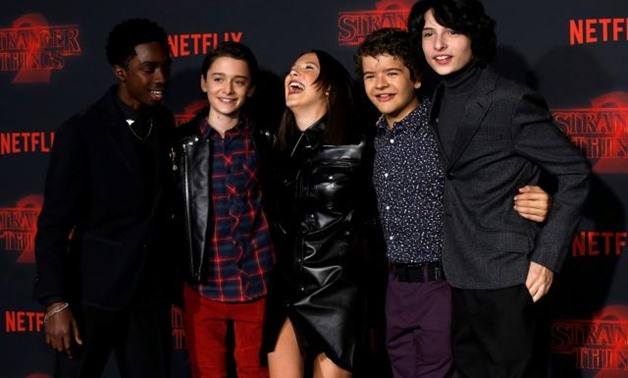 """FILE PHOTO: Cast members (L-R) Caleb McLaughlin, Noah Schnapp, Millie Bobby Brown, Gaten Matarazzo and Finn Wolfhard pose at the premiere for the second season of the television series """"Stranger Things"""" in Los Angeles, California, U.S., October 26, 2017."""