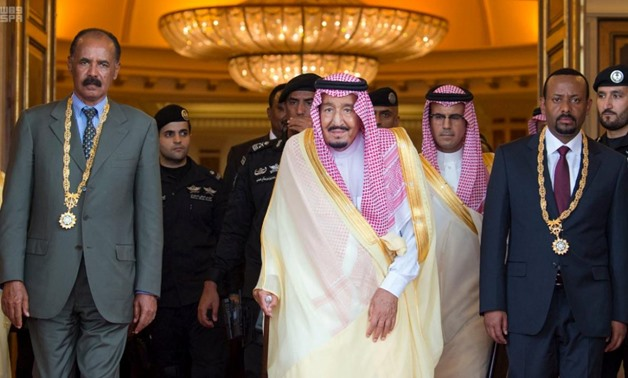 Saudi Arabia's King Salman bin Abdulaziz Al Saud (C), Ethiopia's Prime Minister Abiy Ahmed (R) and Eritrean President Isaias Afwerki pose for the camera during the ceremony to sign a peace agreement in Jeddah, Saudi Arabia September 16, 2018. Saudi News A