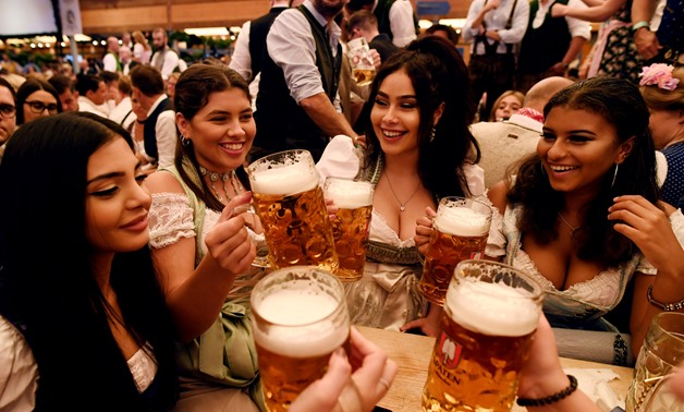 Thousands of visitors, many of them dressed in traditional lederhosen or dirndl corseted dresses, descended on Munich on Saturday for the start of the annual Oktoberfest, the world's largest beer festival - Reuters