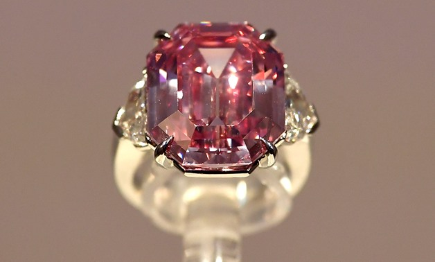 A pink diamond weighing in at almost 19 carats is set to go on tour before being auctioned in Geneva and could fetch a record price of between $30 million and $50 million, Christie's auction house announced on Tuesday.