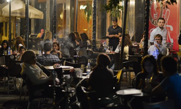 FILE- Egyptians at a cafe