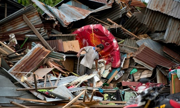 The tsunami was triggered by a strong quake that brought down buildings and sent locals fleeing for higher ground