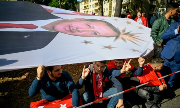 As well as protesters, wellwishers took to the streets of Cologne holding a huge portait of the Turkish president as he arrived to open one of Europe's largest mosques