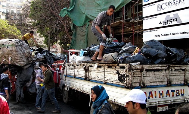garbage bags are loaded on to trucks for disposal or recycling behind the Omar Makram Mosque in Tahrir Square, February, 12, 2011 – Wikimedia/Sherif2982