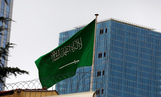 A Saudi flag flutters atop Saudi Arabia's consulate in Istanbul, Turkey, October 4, 2018. REUTERS/Osman Orsal