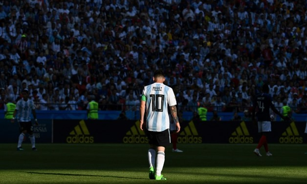 Game over: Argentina's Lionel Messi walking off the pitch after their 4-3 defeat to France at the World Cup.