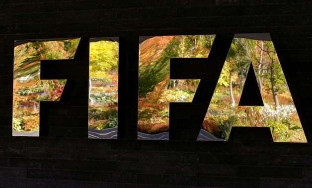 FILE PHOTO: FIFA's logo is seen in front of its headquarters during a meeting of the FIFA executive committee in Zurich, Switzerland September 25, 2015. REUTERS/Arnd Wiegmann