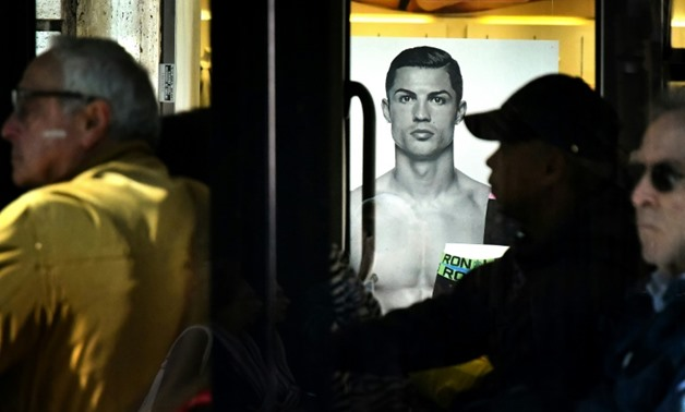A Rome bus drives past an advertising poster for an underwear brand, showing a picture of Juventus' Portuguese forward Cristiano Ronaldo