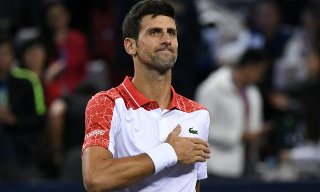 Serbia's Novak Djokovic will become number two in the world after beating Zverev in the Shanghai Masters Final AFP / WANG ZHAO