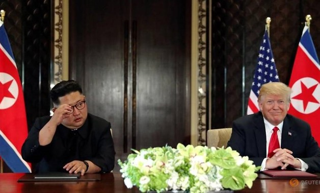FILE PHOTO: U.S. President Donald Trump and North Korea's leader Kim Jong Un hold a signing ceremony at the conclusion of their summit at the Capella Hotel on the resort island of Sentosa, Singapore June 12, 2018. REUTERS/Jonathan Ernst/File Photo