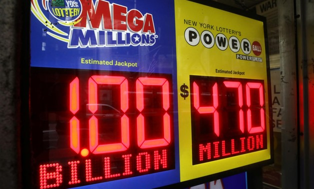 FILE PHOTO: Signs display the jackpots for Mega Millions and Powerball lottery drawings at a newsstands in midtown Manhattan in New York, U.S., October 19, 2018. REUTERS/Mike Sugar