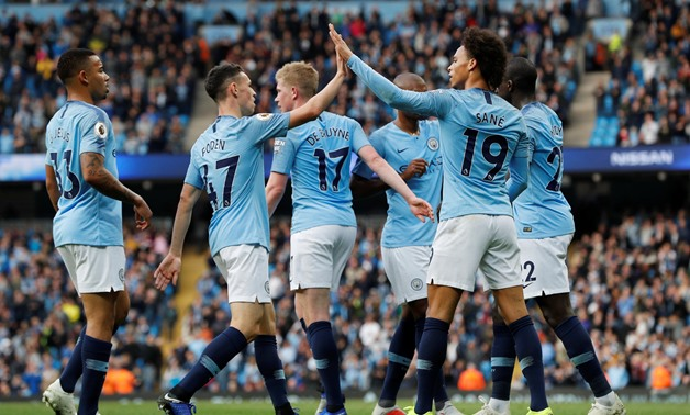 Soccer Football - Premier League - Manchester City v Burnley - Etihad Stadium, Manchester, Britain - October 20, 2018 Manchester City's Leroy Sane celebrates scoring their fifth goal with team mates REUTERS/Darren Staples EDITORIAL USE ONLY. No use with u