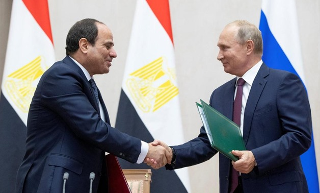 Russian President Vladimir Putin and Egyptian President Abdel Fattah el Sisi shake hands during a signing ceremony following their meeting in the Black Sea resort of Sochi - Reuters