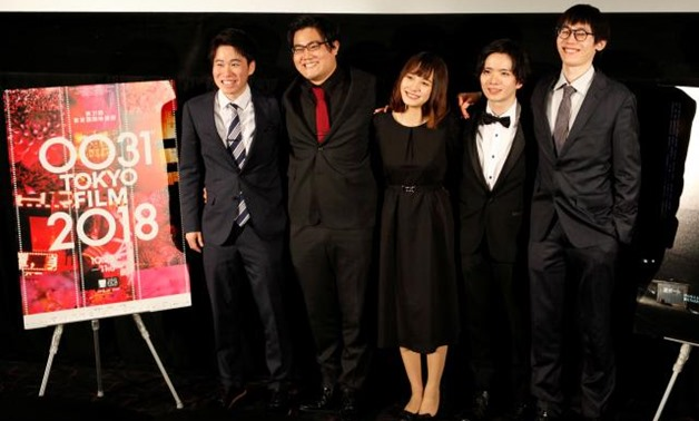 """Director Kensei Takahashi (R) and cast members from """"Sea"""", Seijyuro Mimori, Arisa Sato and Satoshi Abe and producer Taichi Tamura (L) attend a post-screening Q&A session after the film's world premiere at the 31st Tokyo International Film Festival in Toky"""