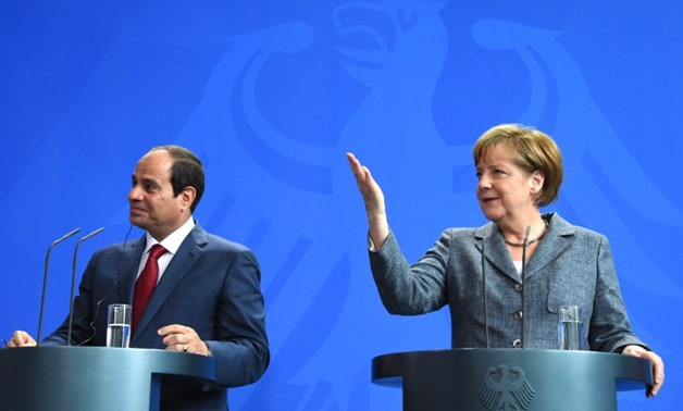 FILE - German Chancellor Angela Merkel and Egyptian President Abdel Fattah el-Sissi attend a press conference on June 3, 2015 at the Chancellery in Berlin - AFP