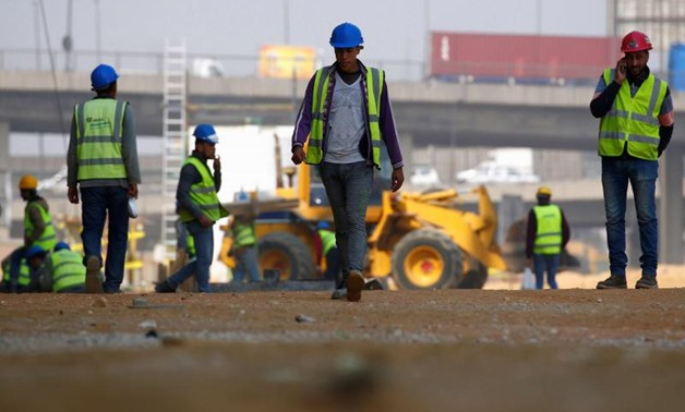 FILE - Construction workers are seen on the outskirts of Cairo - Reuters
