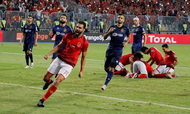 Soccer Football - African Champions League Final - First Leg - Al Ahly vs Esperance Sportive de Tunis - Borg El Arab Stadium, Alexandria, Egypt - November 2, 2018 Al Ahly's Amr Al Sulaya celebrates after teammate Walid Soliman scores their third goal REUT