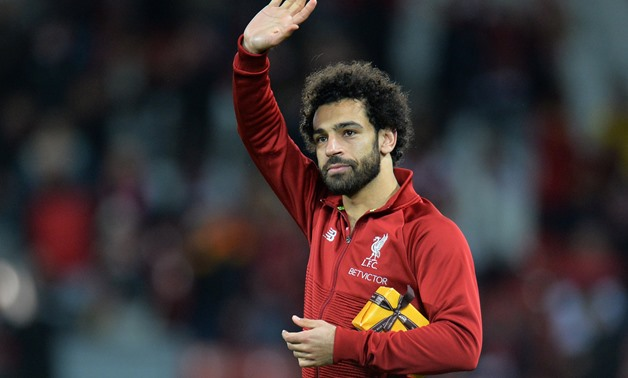 Soccer Football - Champions League - Group Stage - Group C - Liverpool v Crvena Zvezda - Anfield, Liverpool, Britain - October 24, 2018 Liverpool's Mohamed Salah with a gift from a fan after the match REUTERS/Peter Powell