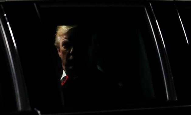 "U.S. President Donald Trump is seen in the presidential limousine, known as ""The Beast"", as he arrives at Orly Airport near Paris to attend commemoration ceremonies for Armistice Day, 100 years after the end of the First World War, France, November 9, 201"