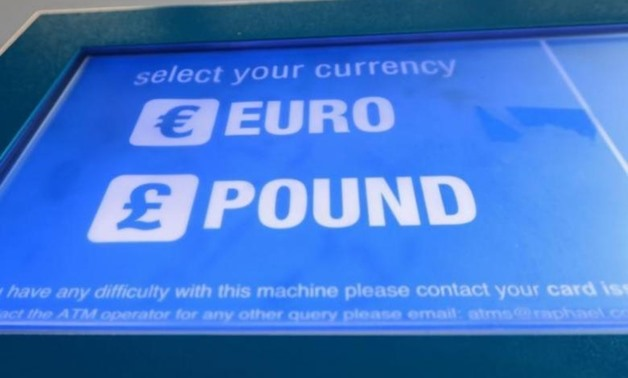 A cash machine ATM that offers withdrawals in either Pound Sterling or Euros is seen in Canary Wharf Financial centre in London, Britain, June 30, 2016. REUTERS/Russell Boyce
