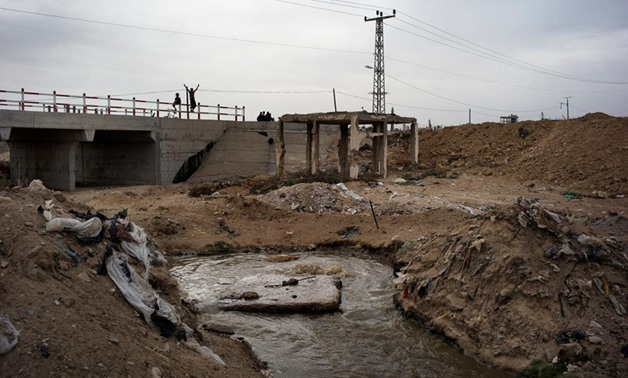 An open pool of sewage is seen in the garbage-filled Wadi Gaza area of the central Gaza Strip on Nov. 27, 2013. Photo Credit: Marco Longari / AFP